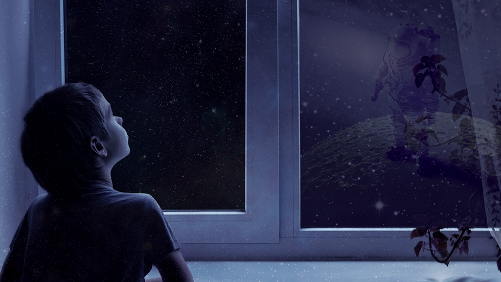 NASA public engagement, child looks out at the moon